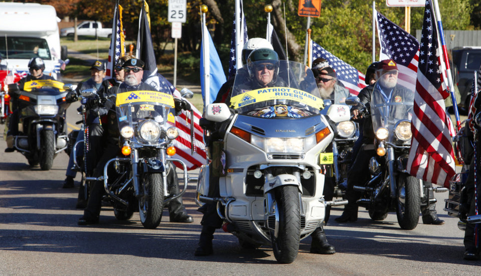 Photo - Patriot Guard Riders participate in last year's Veterans Day parade in Norman.  PHOTOs BY PAUL B. SOUTHERLAND, OKLAHOMAN ARCHIVES