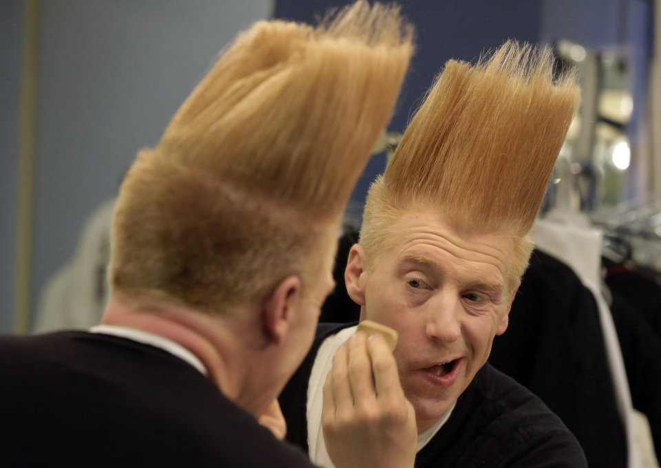 This March 23, 2013 photo shows performer Bello Nock appling make-up in his dressing room as he prepares for his