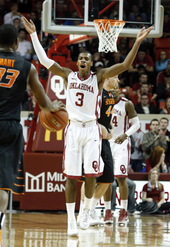 Sooner's Buddy Hield (3) motions for more crowd noise during the second half as the University of Oklahoma Sooners (OU) defeat  the Oklahoma State Cowboys (OSU) 77-68  in NCAA, men's college basketball at The Lloyd Noble Center on Saturday, Jan. 12, 2013  in Norman, Okla. Photo by Steve Sisney, The Oklahoman