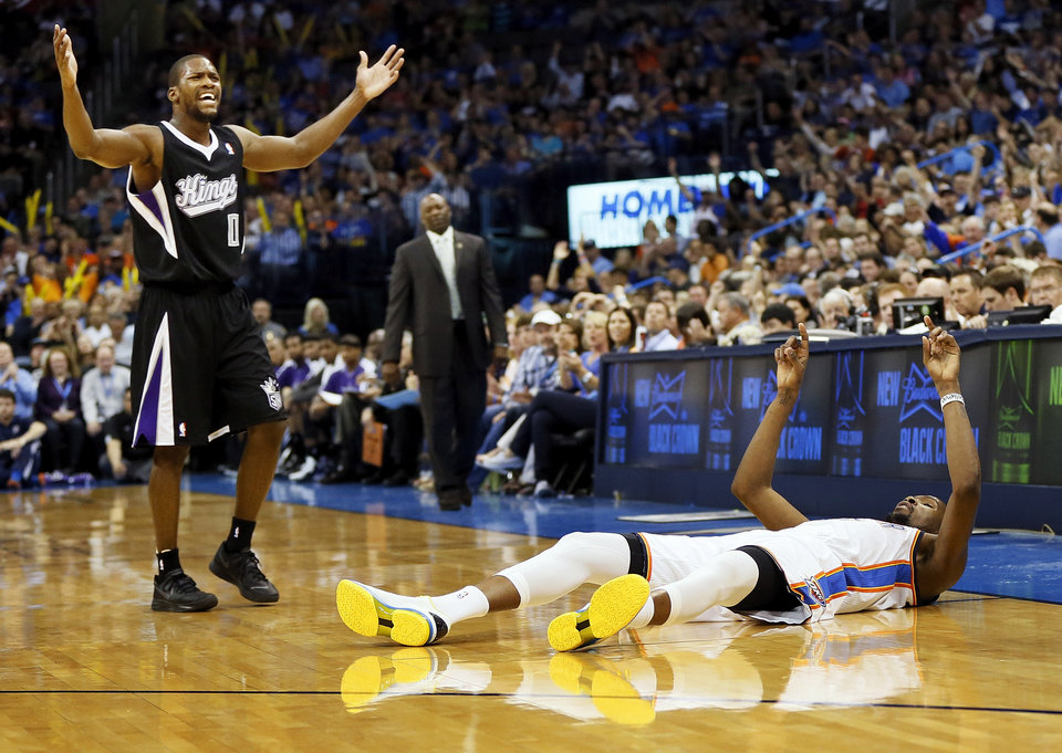 Oklahoma City\'s Kevin Durant (35) and Sacramento\'s Toney Douglas (0) react after Durant hit a 3-point shot and was fouled by Douglas during an NBA basketball game between the Oklahoma City Thunder and the Sacramento Kings at Chesapeake Energy Arena in Oklahoma City, Monday, April 15, 2013. Photo by Nate Billings, The Oklahoman