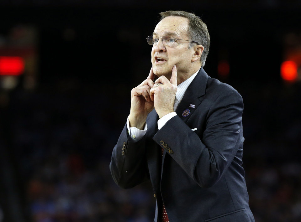Photo - Oklahoma coach Lon Kruger shouts instructions during the national semifinal between the Oklahoma Sooners (OU) and the Villanova Wildcats in the Final Four of the NCAA Men's Basketball Championship at NRG Stadium in Houston, Saturday, April 2, 2016. Photo by Nate Billings, The Oklahoman
