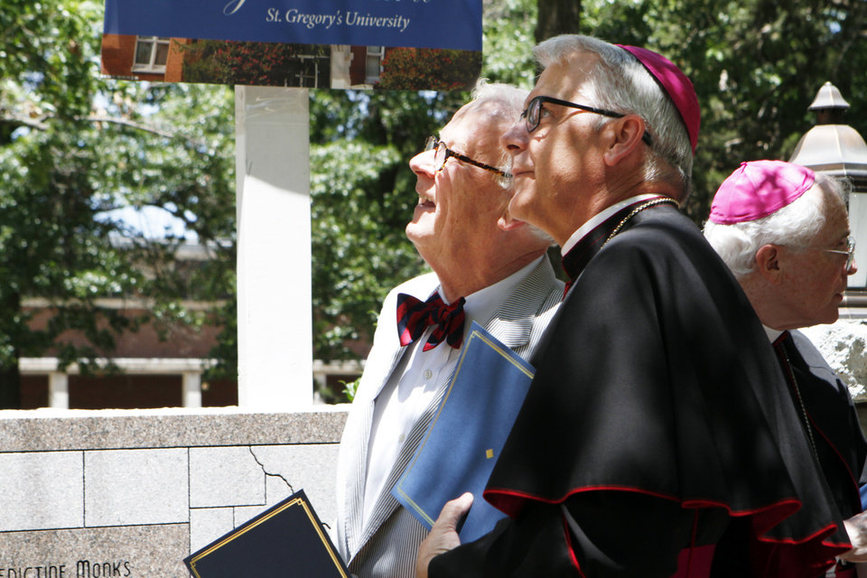 Photo - On Friday, June 28, 2013, Greg Main, president of St. Gregory's University, shows Archbishop Paul S. Coakley construction work underway at one of the buildings on the Shawnee university's campus  Aliki Dyer - The Oklahoman