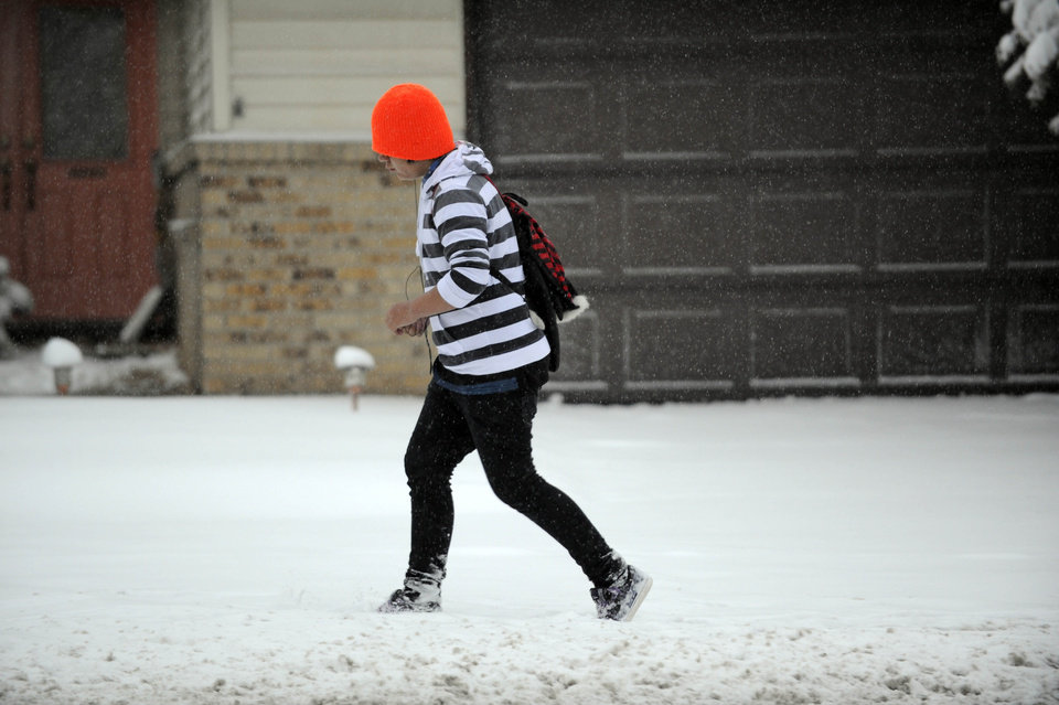 A pedestrian walks through the snow during a snow storm  on Wednesday, Nov 2, 2011  in Denver.     A fast-moving snowstorm is causing blizzard conditions in parts of eastern Colorado. The National Weather Service says gusts up to 40 mph will cause blowing and drifting snow until around noon Wednesday. The mountains west of Denver have also received heavy snow.   (AP Photo/The Denver Post, Andy Cross)  MANDATORY CREDIT ORG XMIT: CODEN108
