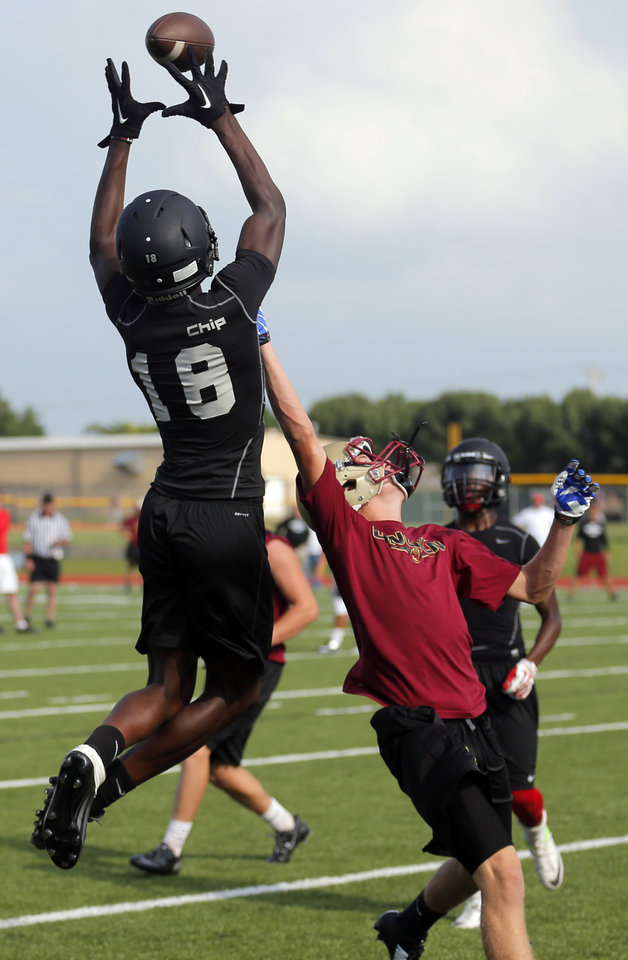 Photo - Westmoore's Dahu Green makes a touchdown pass during a 7 on 7 tournament game at Westmoore High School in Moore, Okla.,  Saturday, June 28, 2014. Photo by Sarah Phipps, The Oklahoman