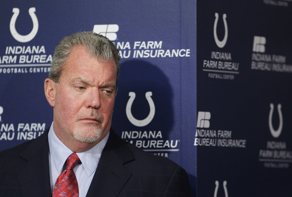 Photo - FILE - In this Jan. 17, 2012 file photo, Indianapolis Colts owner Jim Irsay listens during a news conference at the NFL football team's headquarters in Indianapolis. Authorities say Irsay is in jail after being stopped on suspicion of drunken driving. Hamilton County Sheriff's Department Deputy Bryant Orem says Irsay was arrested Sunday night, March 16, 2014, in the northern Indianapolis suburb of Carmel. (AP Photo/Darron Cummings, File)