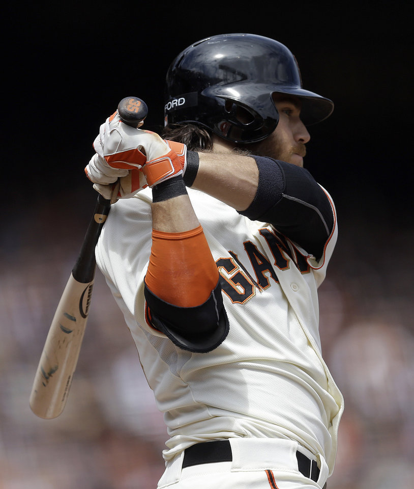 Photo - San Francisco Giants' Brandon Crawford swings for an RBI double off Cleveland Indians' Danny Salazar in the fourth inning of a baseball game, Sunday, April 27, 2014, in San Francisco. (AP Photo/Ben Margot)