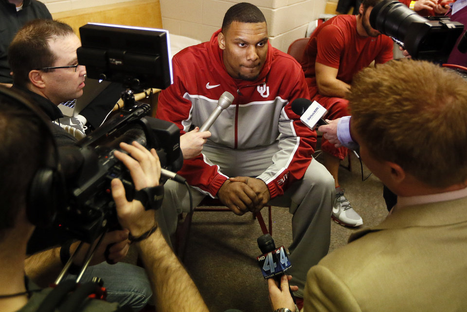 Oklahoma\'s Romero Osby (24) speaks with the media in the OU locker room during the practice and press conference day for the second round of the NCAA men\'s college basketball tournament at the Wells Fargo Center in Philadelphia, Thursday, March 21, 2013. OU will play San Diego State in the second round on Friday. Photo by Nate Billings, The Oklahoman