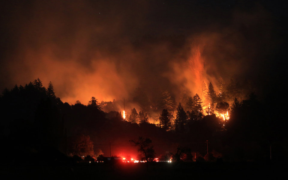 A wind driven vegetation fire eats up timber at the Yellow Jacket Ranch east of Highway 128, early Wednesday May 1, 2013 in Knights Valley, Calif., on the Napa and Sonoma County line. Crews battled two small wildfires on Wednesday in California wine country that were pushed by gusty winds. (AP Photo/The Press Democrat, Kent Porter)