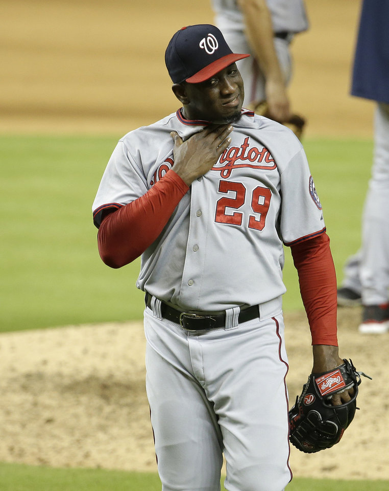 Photo - Washington Nationals relief pitcher Rafael Soriano (29) walks to the dugout after being relieved in the ninth inning during a baseball game against the Miami Marlins, Monday, July 28, 2014, in Miami. The Marlins scored four runs in the ninth inning to come from behind and defeat the Nationals 7-6. (AP Photo/Lynne Sladky)