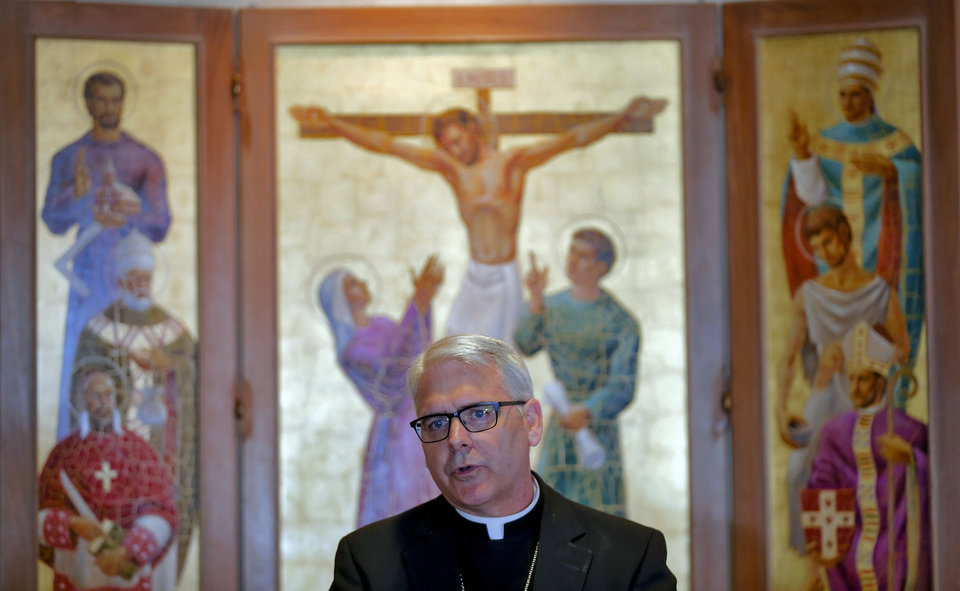 Photo - Archbishop Paul S. Coakley speaks during a  news conference about the resignation of Pope Benedict XVI Monday at the Catholic Pastoral Center in Oklahoma City. Photo by Chris Landsberger, The Oklahoman  CHRIS LANDSBERGER - CHRIS LANDSBERGER