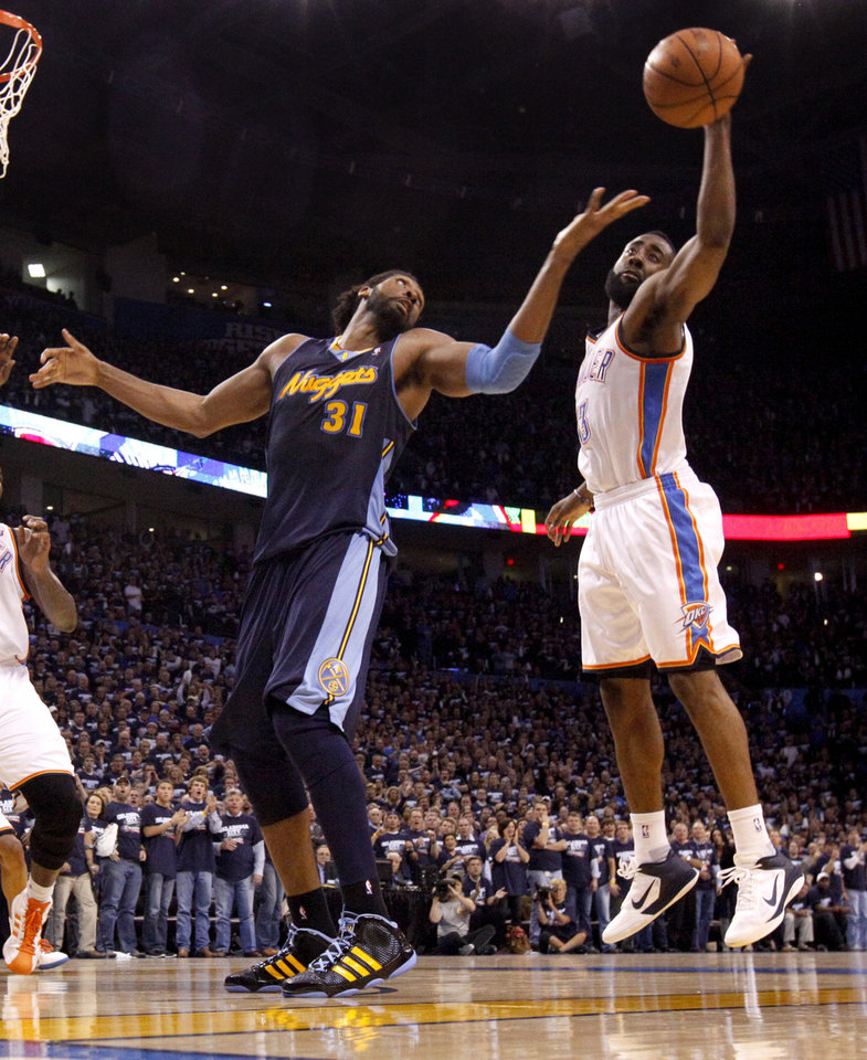 Oklahoma City's James Harden (13) reaches for the ball next to Denver's Nene (31) during the NBA basketball game between the Denver Nuggets and the Oklahoma City Thunder in the first round of the NBA playoffs at the Oklahoma City Arena, Wednesday, April 27, 2011. Photo by Bryan Terry, The Oklahoman