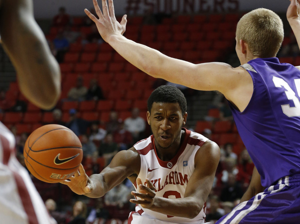 Oklahoma\'s Steven Pledger (2) pass the ball beside Stephen F. Austin\'s Jacob Parker (34) during a college basketball game between the University of Oklahoma (OU) and Stephen F. Austin University at the Lloyd Noble Center in Norman, Okla., Tuesday, Dec. 18, 2012. Photo by Bryan Terry, The Oklahoman