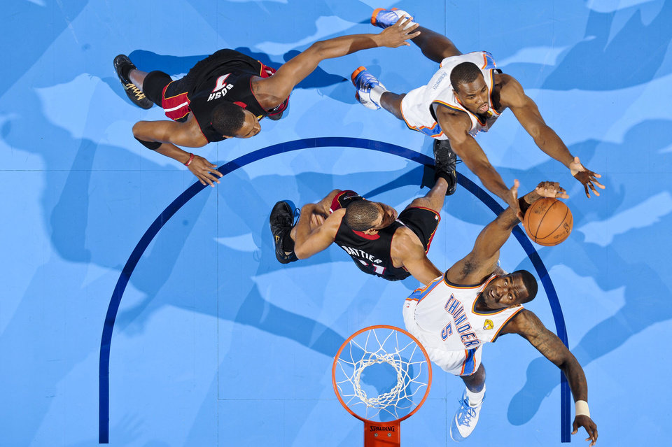 OKC Thunder No. 5 Kendrick Perkins and No. 9 Serge Ibaka go for a rebound against the Miami Heat in Game 2 of the NBA Finals in Oklahoma City. <strong>PHOTO BY ANDREW D. BERNSTEIN - NBAE/Getty Images</strong>