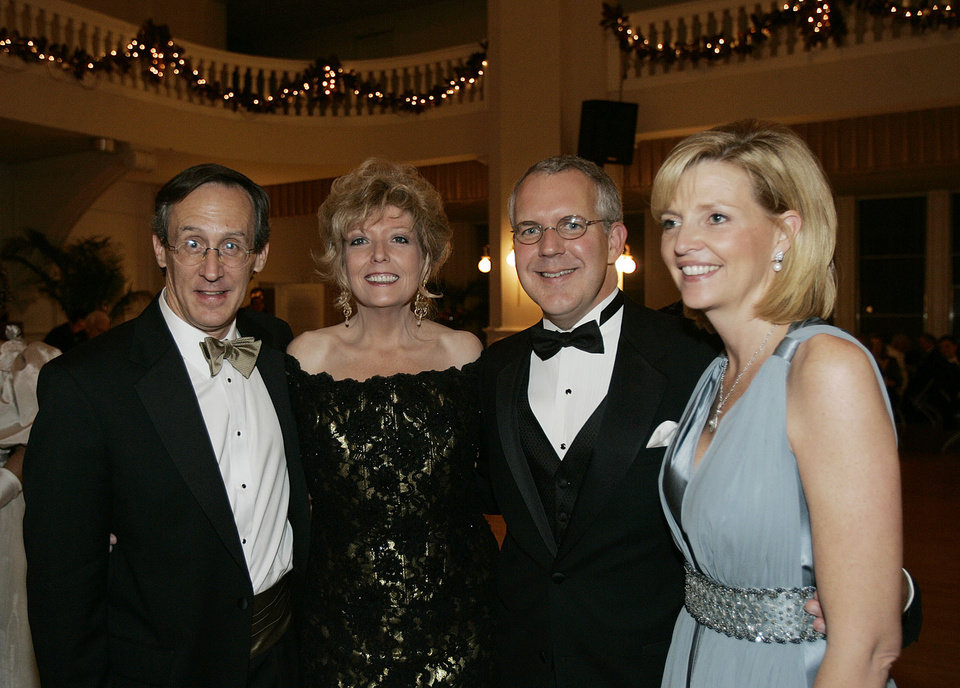 Photo - Centennial Ball Chairman Jim Dewhurst, left, and his wife, Theresa, pose for a photo with Oklahoma Gov. Brad Henry and his wife, Kim, right, at the Oklahoma Centennial Statehood Inaugural Ball, Saturday, Nov. 17, 2007, at the Guthrie Scottish Rite Masonic Center, in Guthrie, Okla. By Bill Waugh, The Oklahoman
