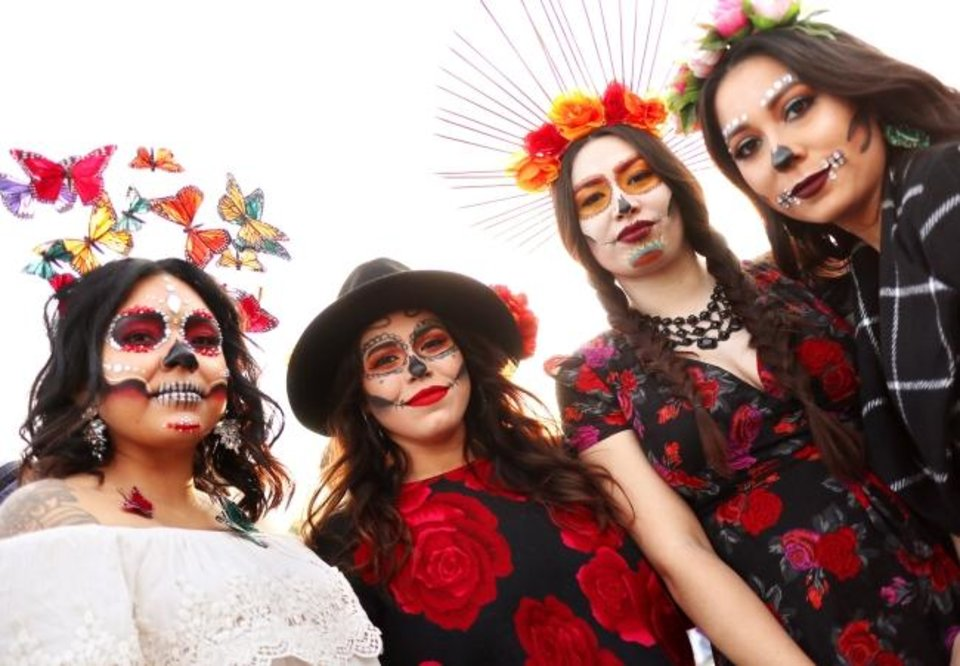 Photo -  Attending the Plaza District's Day of the Dead Festival were, from left, Steph Maza, Maggie Flores, Delaney Cisneros-Manzo and Lucila Gutierrez. [DOUG HOKE/THE OKLAHOMAN]