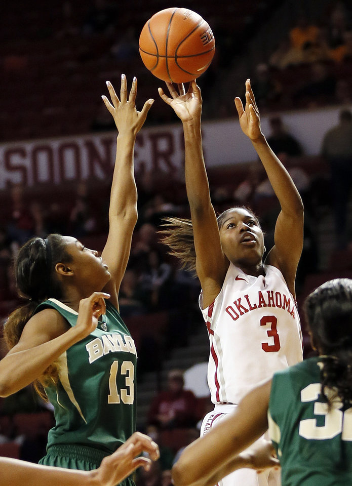 Photo - Oklahoma's Aaryn Ellenberg (3) shoots as Baylor's Chardonae Fuqua' (13) defends during a women's college basketball game between the University of Oklahoma and Baylor at the Lloyd Noble Center in Norman, Okla., Monday, Feb. 25, 2013. Baylor beat OU, 86-64. Photo by Nate Billings, The Oklahoman
