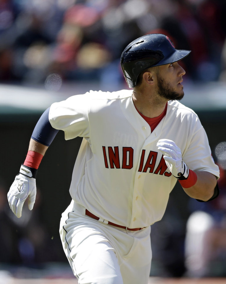 Photo - Cleveland Indians' Yan Gomes watches his ball after hitting a two-run home run off Minnesota Twins starting pitcher Ricky Nolasco in the second inning of a baseball game on Sunday, April 6, 2014, in Cleveland. Indians' Michael Brantley also scored. (AP Photo/Tony Dejak)