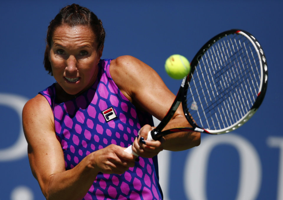 Photo - Jelena Jankovic, of Serbia, returns a shot against Johanna Larsson, of Sweden, during the third round of the 2014 U.S. Open tennis tournament, Friday, Aug. 29, 2014, in New York. (AP Photo/Matt Rourke)