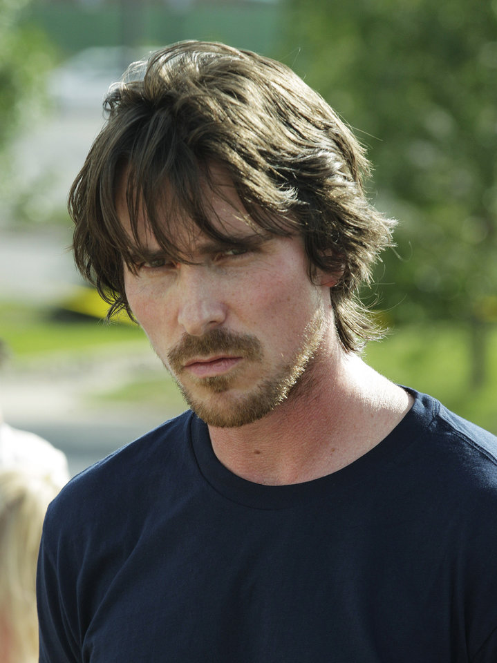 Photo -   Actor Christian Bale visits a memorial to the victims of Friday's mass shooting, Tuesday, July 24, 2012, in Aurora, Colo. Twelve people were killed when a gunman opened fire during a late-night showing of the movie Dark Knight Rises, which stars Bale as Batman. (AP Photo/Ted S. Warren)