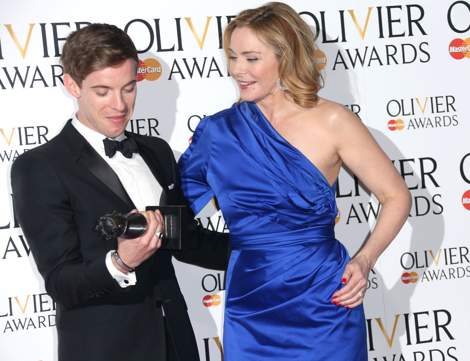 Photo - Luke Treadaway, winner of Best Actor Award for The Curious Incident of the Dog in the Night-time and Kim Cattrall  in the press room at the Olivier Awards 2013 at the Royal opera House in London on Sunday, April 28th, 2013. (Photo by Joel Ryan/Invision/AP)