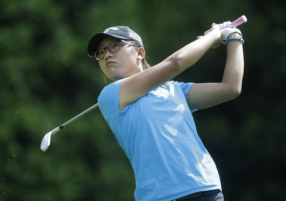 Photo - Lydia Ko, of New Zealand, watches her tee shot on the fifth hole during the final round of the Kingsmill Championship golf tournament at the Kingsmill resort  in Williamsburg, Va., Sunday, May 18, 2014.   (AP Photo/Steve Helber)