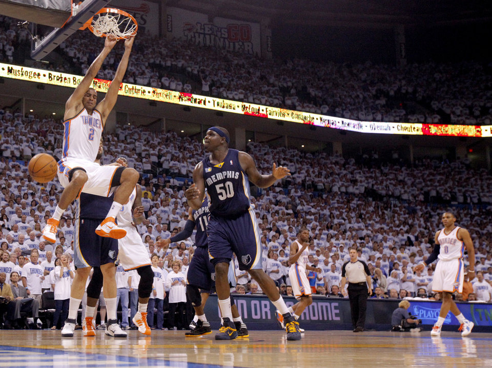 Photo - Oklahoma City's Thabo Sefolosha (2) dunks the ball during game five of the Western Conference semifinals between the Memphis Grizzlies and the Oklahoma City Thunder in the NBA basketball playoffs at Oklahoma City Arena in Oklahoma City, Wednesday, May 11, 2011. Photo by Bryan Terry, The Oklahoman