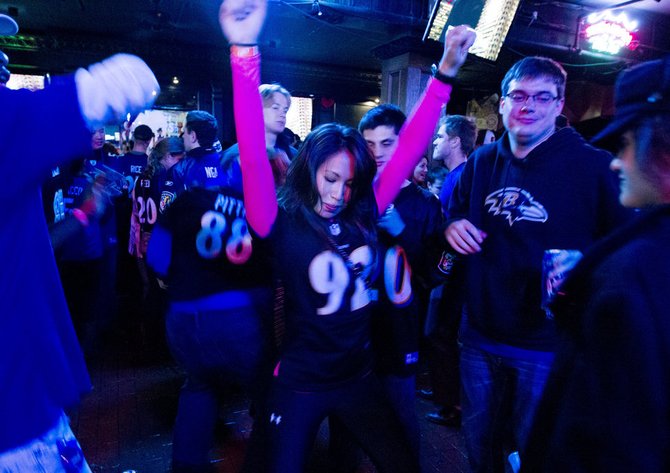 Photo - Baltimore Ravens fans celebrate after their team scored the third touchdown against the San Francisco 49ers, during the Super Bowl at local pub in Baltimore on Sunday Feb. 3, 2013. (AP Photo/Jose Luis Magana)