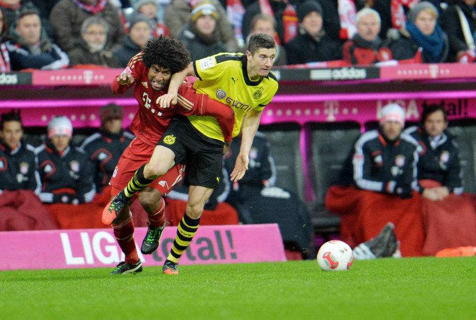 Photo - Bayern's Dante of Brazil, left, and Dortmund's Robert Lewandowski of Poland challenge for the ball during the German first division Bundesliga soccer match between FC Bayern Munich and Bourussia Dortmund  in Munich, Germany, Saturday, Dec. 1, 2012. (AP Photo/Kerstin Joensson)