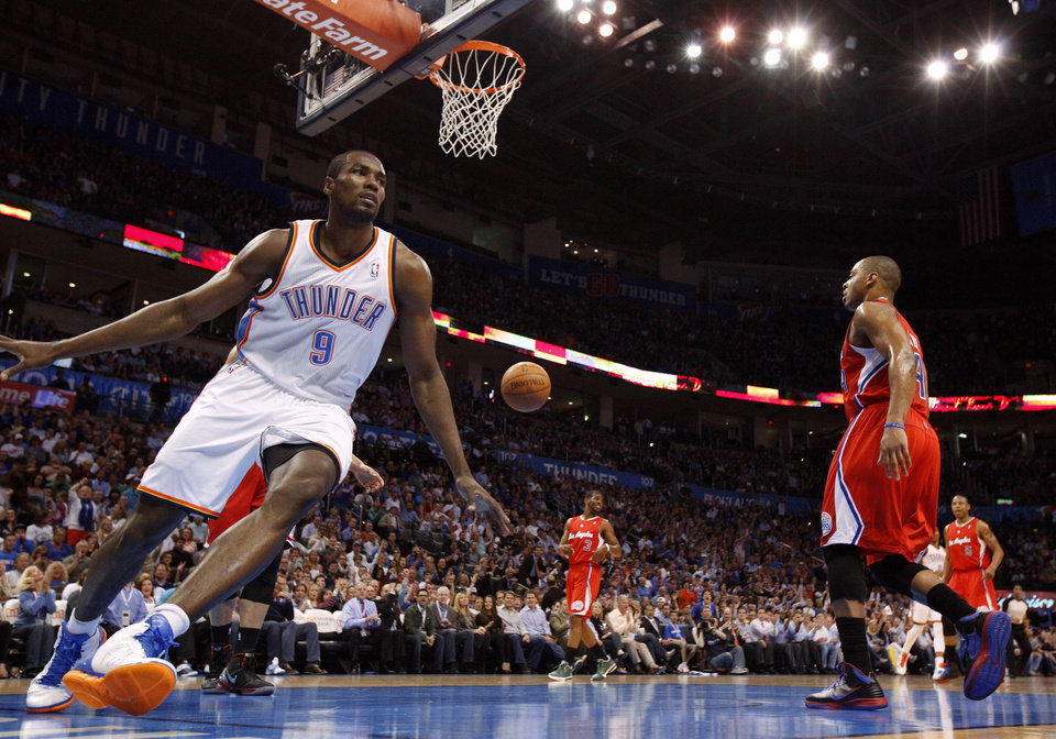 Photo - Oklahoma City's Serge Ibaka (9) celebrates after a basket during the NBA basketball game between the Oklahoma City Thunder and the Los Angeles Clippers at Chesapeake Energy Arena in Oklahoma City, Wednesday, April 11, 2012. Photo by Bryan Terry, The Oklahoman