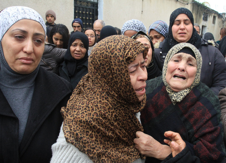 Photo - Tunisian women gather in front of the house of slain opposition leader Chokri Belaid's father prior to his funeral in Tunis, Friday, Feb. 8, 2013. Tunisia braced for clashes on Friday, with the capital shut down by a general strike and the army deployed for the funeral of a slain opposition leader expected to draw tens of thousands of mourners, and potentially many more. (AP Photo/Amine Landoulsi)