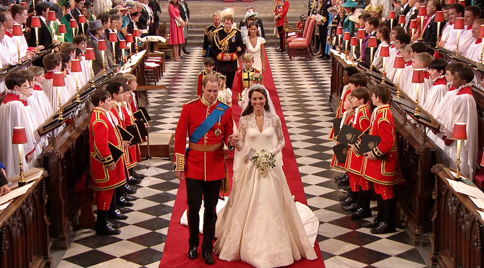 Photo - In this image taken from video, Britain's Prince William, left, and his wife, Kate, the Dutchess of Cambridge, walk down the aisle together at Westminster Abbey for the Royal Wedding in London on Friday, April, 29, 2011. (AP Photo/APTN) EDITORIAL USE ONLY NO ARCHIVE PHOTO TO BE USED SOLELY TO ILLUSTRATE NEWS REPORTING OR COMMENTARY ON THE FACTS OR EVENTS DEPICTED IN THIS IMAGE ORG XMIT: RWVM300