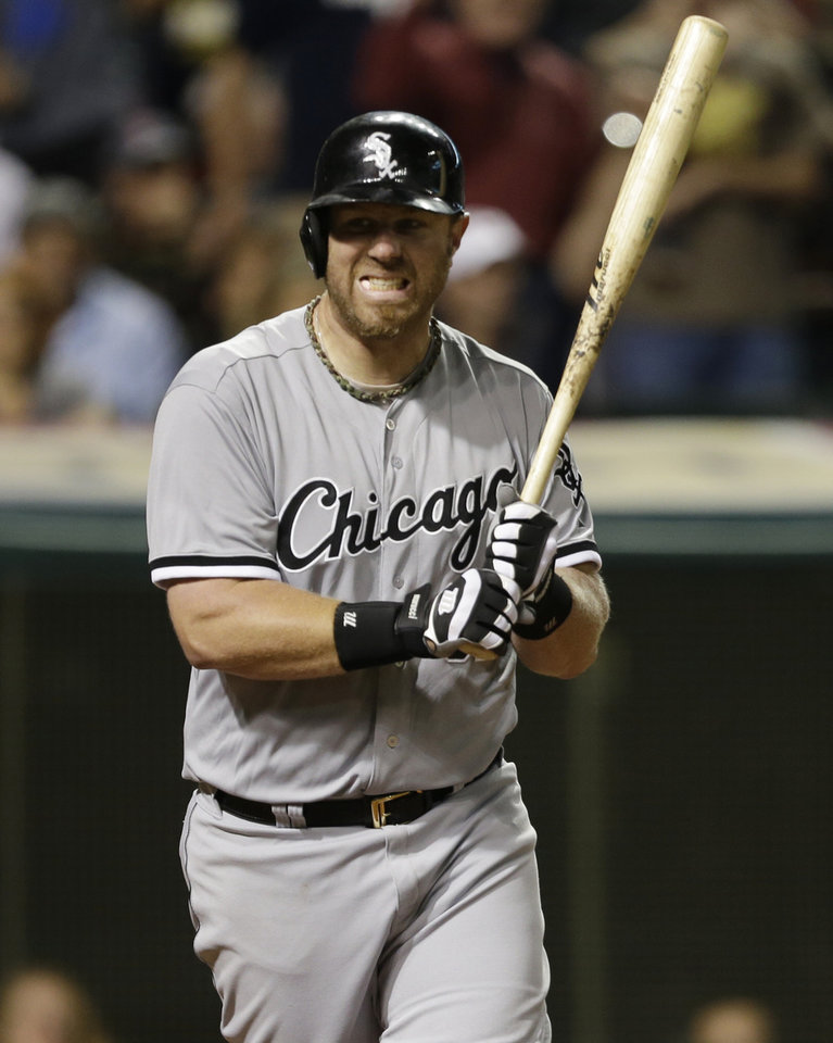 Photo - Chicago White Sox's Adam Dunn reacts after striking out against Cleveland Indians relief pitcher Rich Hill in the eighth inning in a baseball game, Monday, July 29, 2013, in Cleveland. (AP Photo/Tony Dejak)