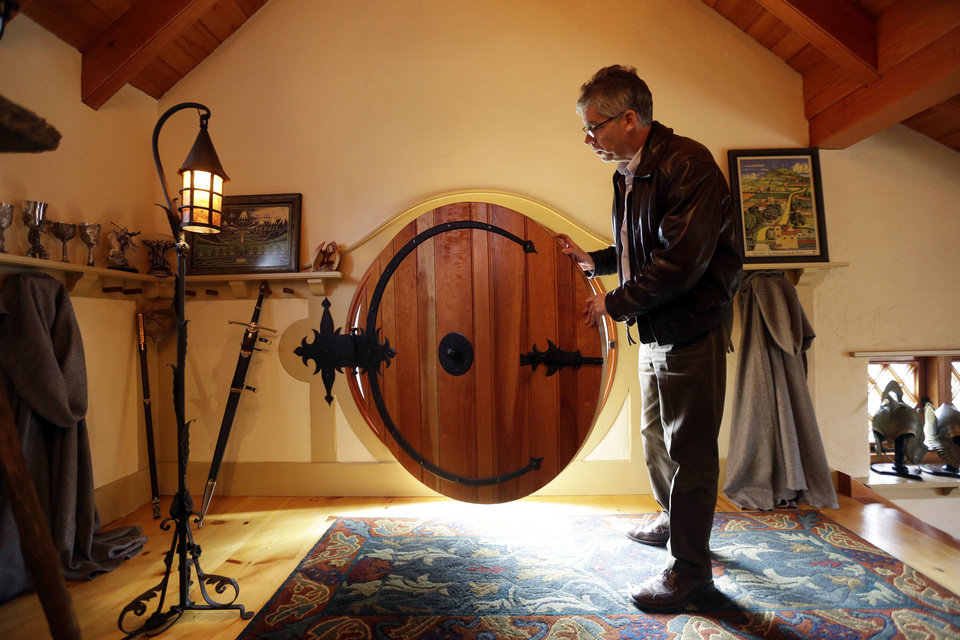 Architect Peter Archer closes the front door of the �Hobbit House� during an interview with the Associated Press Tuesday, Dec. 11, 2012, in Chester County, near Philadelphia.  Archer has designed a �Hobbit House� containing a world-class collection of J.R.R. Tolkien manuscripts and memorabilia. AP photo