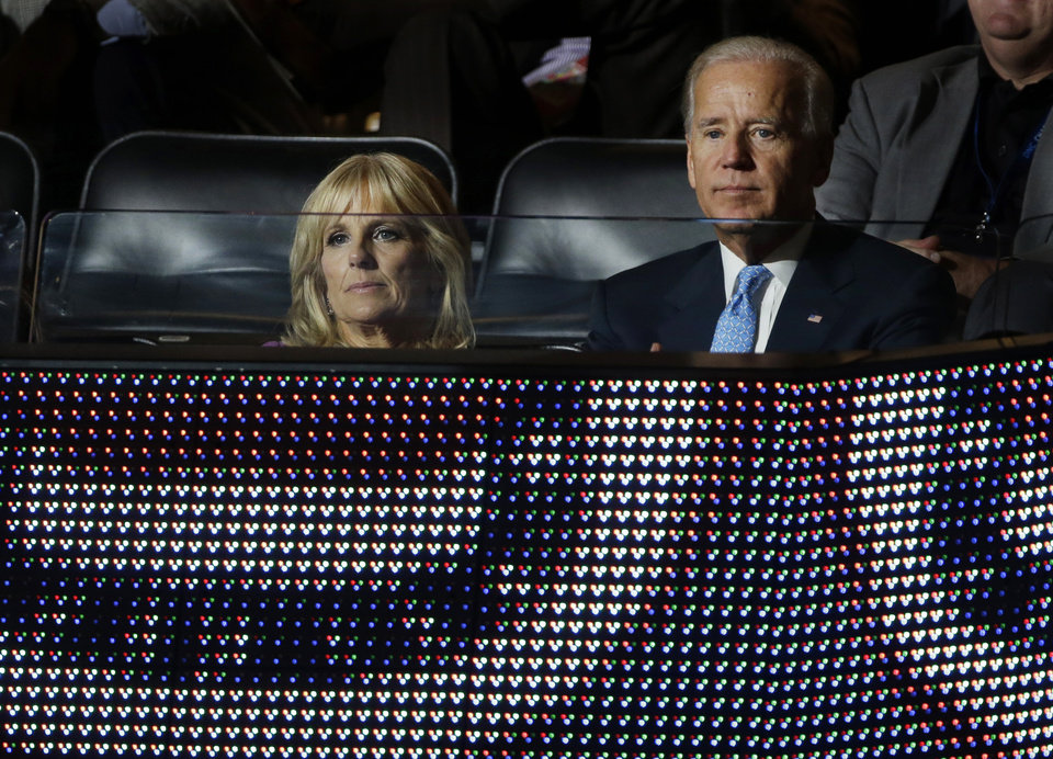 Photo - Vice President Joe Biden and his wife Jill watch speakers at the Democratic National Convention in Charlotte, N.C., on Wednesday, Sept. 5, 2012. (AP Photo/Charlie Neibergall)  ORG XMIT: DNC173