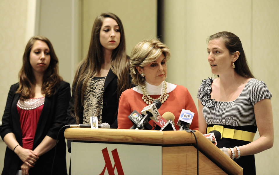 Photo - Kylie Angell, right, speaks to the media as attorney Gloria Allred, second from right, Erica Daniels, left, and Carolyn Luby, second from left, listen, during a news conference, Wednesday, Jan. 10, 2007, in Hartford, Conn. The University of Connecticut will pay nearly $1.3 million to settle a federal lawsuit filed by five women who claimed the school responded to their sexual assault complaints with indifference, the two sides announced Friday.  (AP Photo/Jessica Hill)