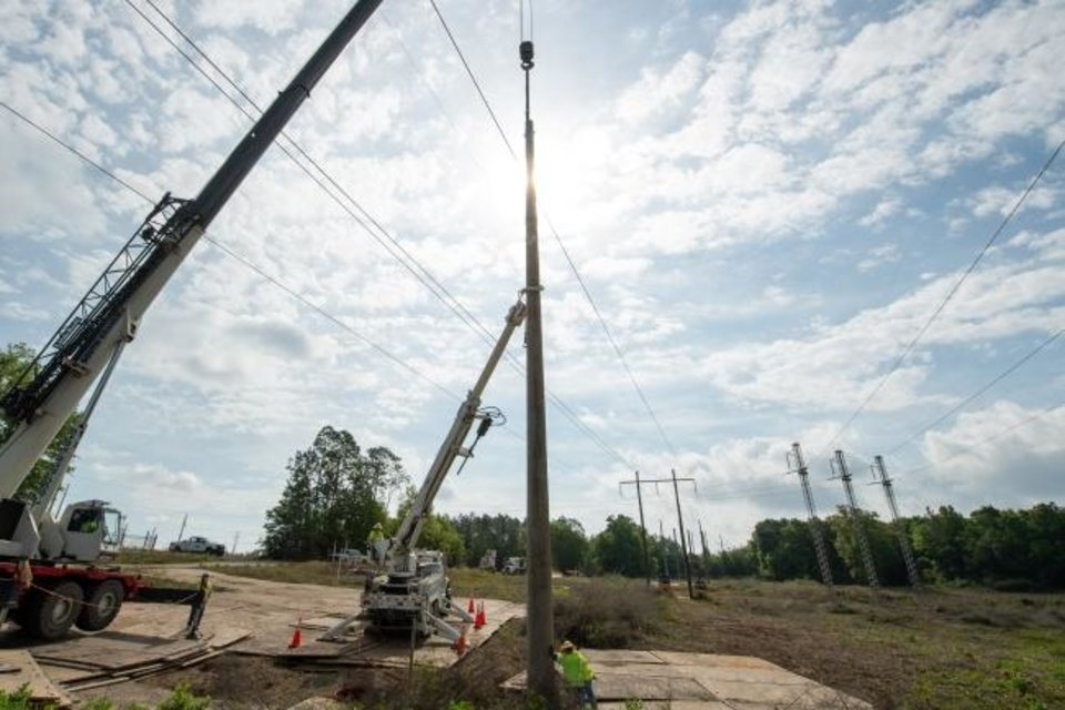 Photo -  A concrete transmission pole is installed as part of a grid hardening project by Florida Power and Light earlier this year. [PROVIDED BY FLORIDA POWER AND LIGHT]