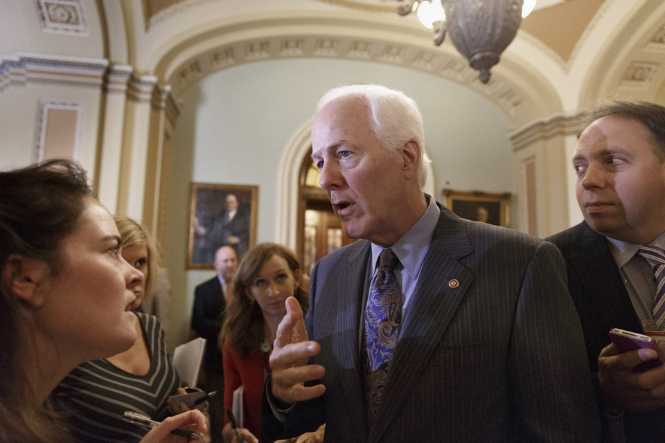 Photo - Senate Minority Whip John Cornyn of Texas speaks to reporters on Capitol Hill in Washington, Tuesday, June 17, 2014, after a Republican strategy session. President Barack Obama will meet with Congressional leaders at the White House on Wednesday to discuss the turmoil in Iraq. (AP Photo/J. Scott Applewhite)