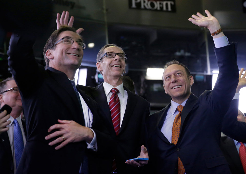 Photo - Sabre Corp. President & CEO Tom Klein, right, and company CFO Rick Simonson, center, are joined by Nasdaq CEO Robert Greifeld as they wait for Sabre's IPO to begin trading, at the Nasdaq MarketSite, in New York,  Thursday, April 17, 2014. (AP Photo/Richard Drew)