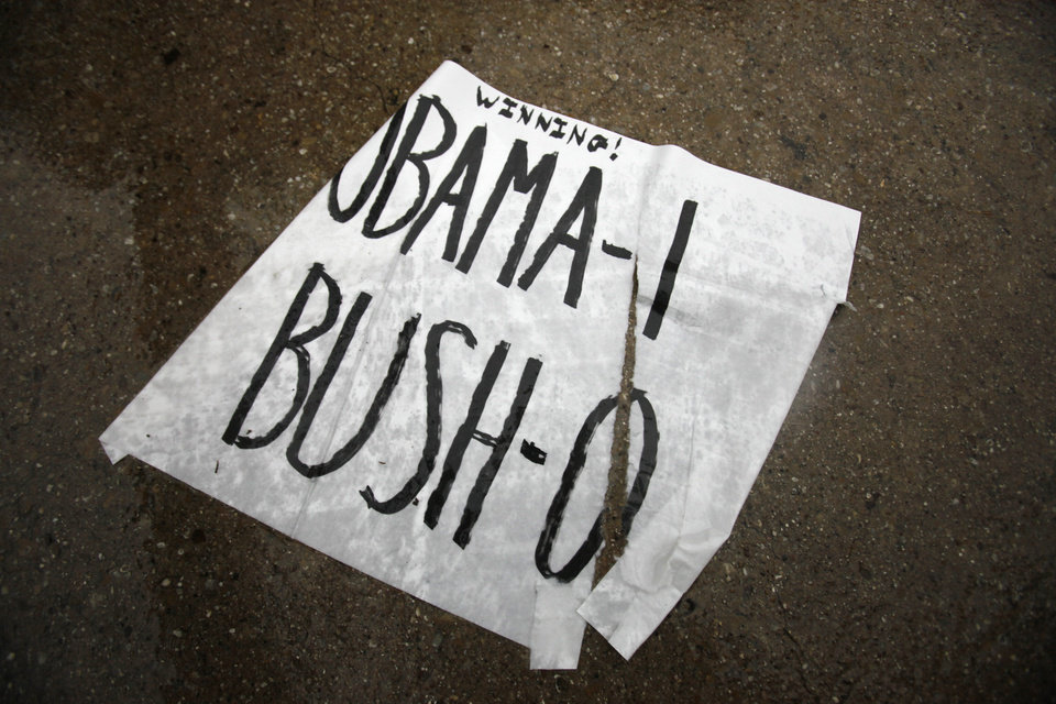 Photo - A rain soaked sign sits on the ground in front of the gated Dallas neighborhood of former U.S. President George W. Bush in  Dallas, Texas, Monday, May 2, 2011. President Barack Obama announced Sunday night that Osama bin Laden was killed in an operation led by the United States.  (AP Photo/LM Otero) ORG XMIT: TXMO102
