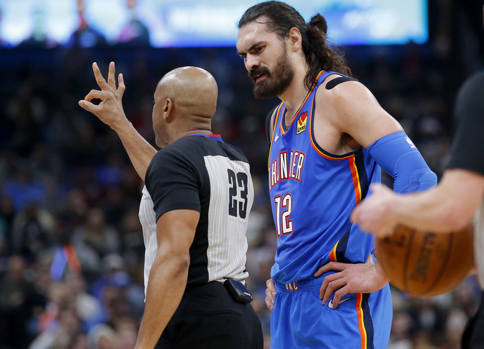 Photo - Oklahoma City's Steven Adams (12) argues a call during the NBA basketball game between the Oklahoma City Thunder and the Phoenix Suns at the Chesapeake Energy Arena in Oklahoma City , Friday, Dec. 20, 2019.   [Sarah Phipps/The Oklahoman]
