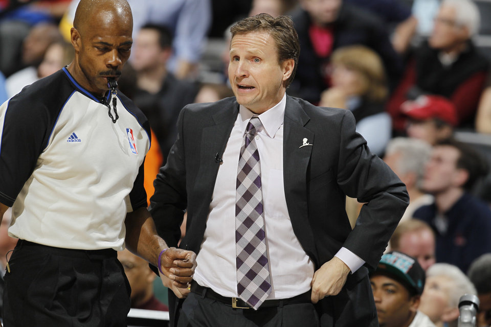 Oklahoma City Thunder head coach Scott Brooks, right, argues a call against his team with referee Tom Washington while facing the Denver Nuggets in the first quarter of an NBA basketball game in Denver on Friday, March 1, 2013. (AP Photo/David Zalubowski) ORG XMIT: CODZ104