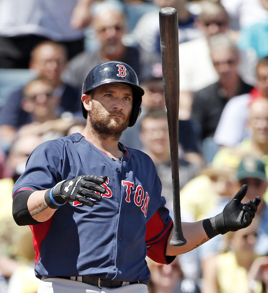 Photo - Boston Red Sox Jonny Gomes tosses his bat after striking out in the third inning of a spring exhibition baseball game against the New York Yankees in Tampa, Fla., Tuesday, March 18, 2014.  (AP Photo/Kathy Willens)