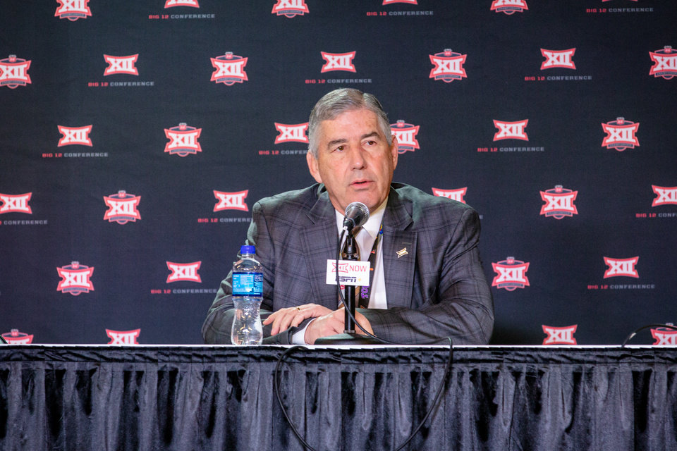 Photo - Mar 12, 2020; Kansas City, Missouri, USA; Big 12 commissioner Bob Bowlsby speaks to reporters during the press conference cancelling tournament games at Sprint Center. Mandatory Credit: William Purnell-USA TODAY Sports