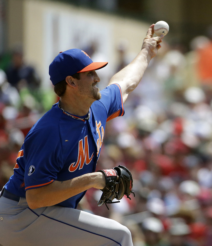 Photo - New York Mets starting pitcher Jonathon Niese throws in the first inning of an exhibition spring training baseball game against the St. Louis Cardinals, Sunday, March 16, 2014, in Jupiter, Fla. (AP Photo/David Goldman)