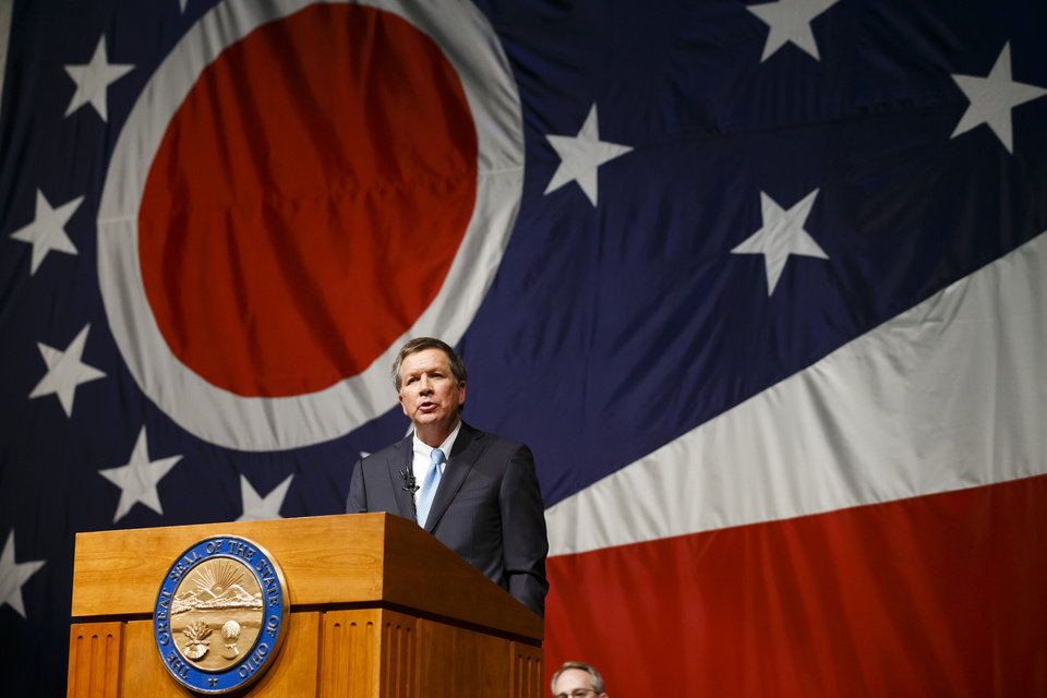 Photo - Ohio Gov. John Kasich delivers his State of the State address at Veterans Memorial Civic and Convention Center in Lima, Ohio, Tuesday, Feb. 19, 2013. (AP Photo/Rick Osentoski)