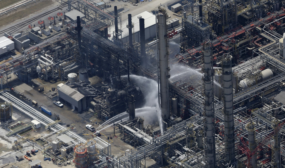 Photo - A chemical plant fire is seen in this aerial photo about twenty miles southeast of Baton Rouge, in Geismer, La., Thursday, June 13, 2013.  Ambulances and helicopters took at least 30 people from the burning chemical plant after an explosion Thursday, officials said. Early tests did not indicate dangerous levels of any chemicals around the plant, but area residents were told to remain indoors with doors and windows closed, said Jean Kelly, spokeswoman for the state Department of Environmental Quality. (AP Photo/Gerald Herbert)