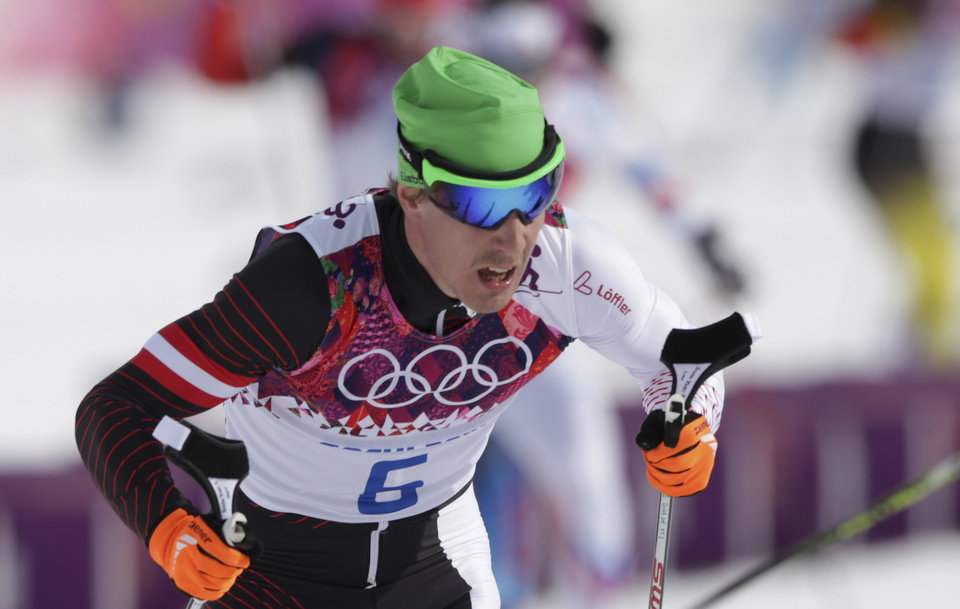 Photo - In this Feb. 9, 2014 photo Austria's Johannes Duerr competes during the men's cross-country 30k skiathlon at the 2014 Winter Olympics in Krasnaya Polyana, Russia. Duerr has been kicked out of the Sochi Games after testing positive for EPO, the country's Olympic committee said Sunday, Feb 23, 2014. It is the fifth doping case of the Olympics and the first involving the blood-boosting drug EPO. (AP Photo/Matthias Schrader)