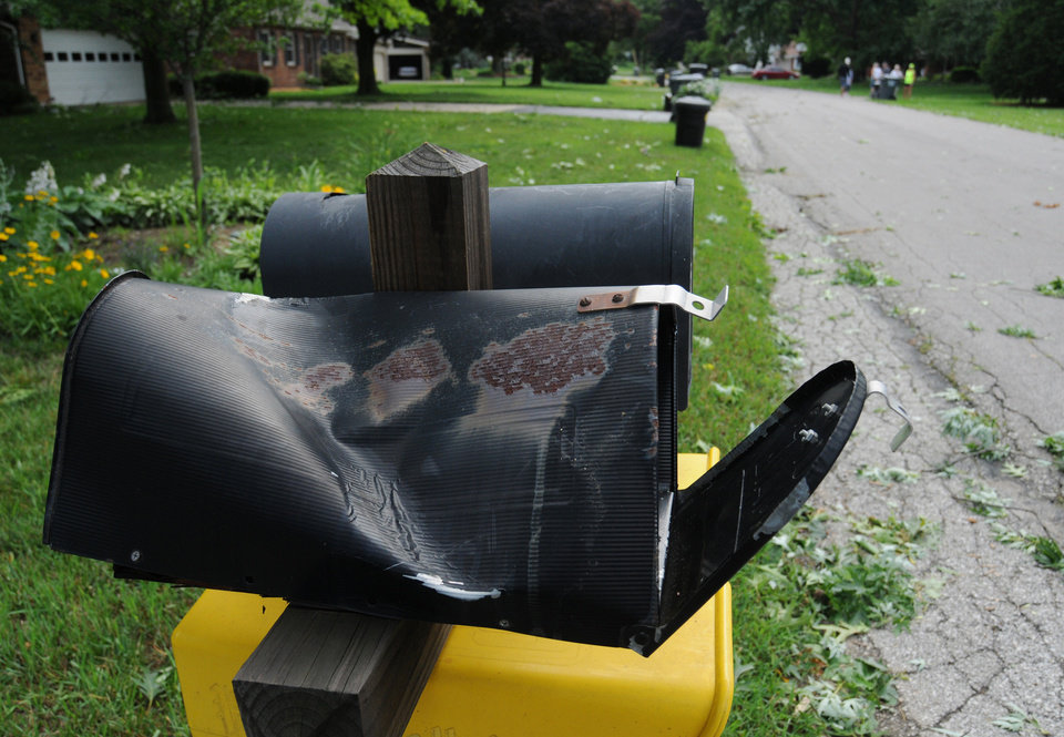 Photo - A damaged stands after a storm in St. Joseph Township, Mich., Tuesday, July 1, 2014. Severe thunderstorms packing high winds knocked down trees and power lines across parts of Michigan, leaving more than 230,000 without power and injuring a firefighter. (AP Photo/The Herald-Palladium, Don Campbell)