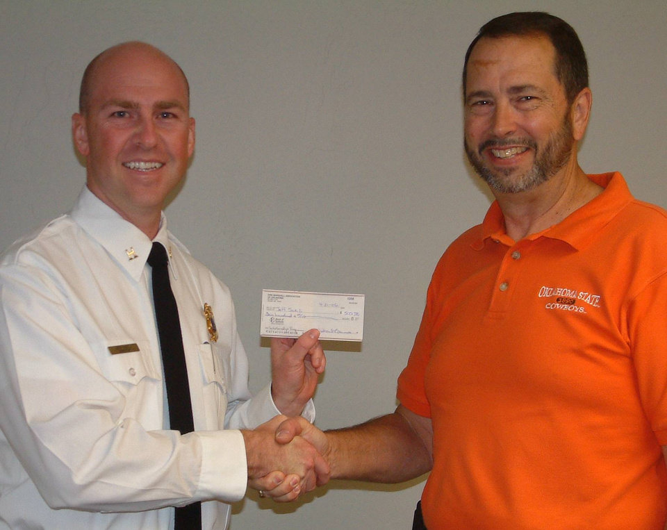 Ed Steiner, president of the Fire Marshal's Association of Oklahoma presents Jeff Sceili with scholarship check.<br/><b>Community Photo By:</b> Angie Hladik<br/><b>Submitted By:</b> Jerry,
