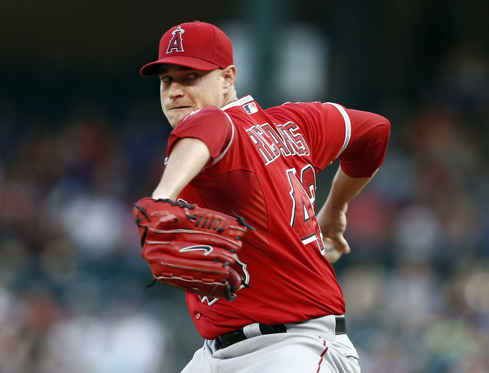 Photo - Los Angeles Angels starting pitcher Garrett Richards throws to the Texas Rangers during the first inning of a baseball game, Friday, Aug. 15, 2014, in Arlington, Texas. (AP Photo/Jim Cowsert)